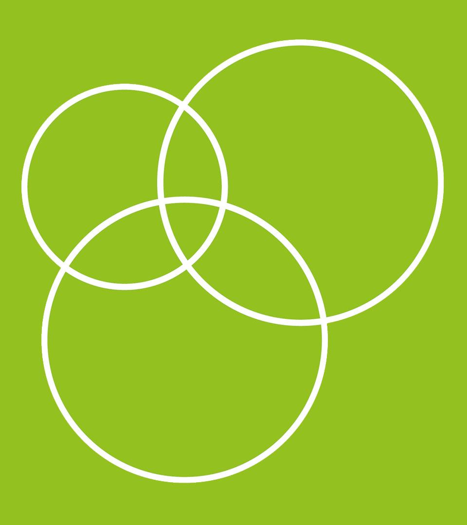 Vita cirklar på en grön bakgrund.